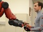 The Baxter robot hands off a cable to a human