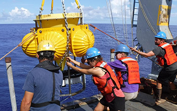 scientists and crew of the R/V Atlantic Explorer recover a deep ocean sediment trap