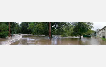 Image of a flooded area with houses on right side.