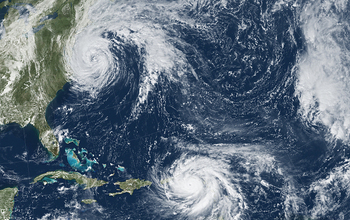 Satellite view of hurricanes off the US East Coast and in the Caribbean.