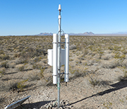 A cosmic-ray neutron soil moisture sensor measures the average soil moisture of the watershed.