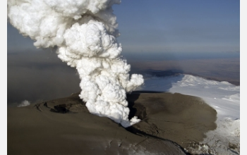 The eruption in Iceland after it penetrated Eyjafjallajökull's icecap; new ash covers the glacier.