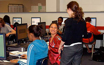 Photo of Julia Barnathan assisting a student with a lesson