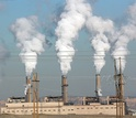image of power plant with smoking chimneys