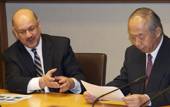 Farnam Jahanian and Masao Sakauchi talking during a meeting
