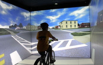 Kid on a stationary bike in the Hank Virtual Environments Lab