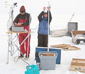 Photo of scientists installing a monitoring station in Greenland