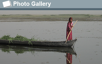 Photo of girl in boat and the words Photo Gallery.