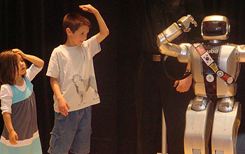 Two kids and robot Jaemi HUBO playing Simon Says.