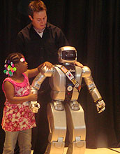 A little girl and robot Jaemi HUBO, with researcher