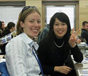 Photo of students  Katherine Burgess and Sakiko Goto sharing a light moment..