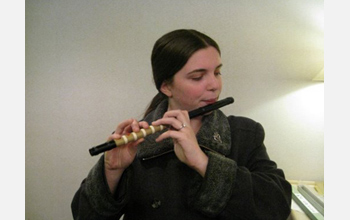 Photo of woman playing a  Japanese flute.