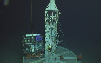 A watertight seafloor well is used to take samples from aquifers deep beneath the ocean.