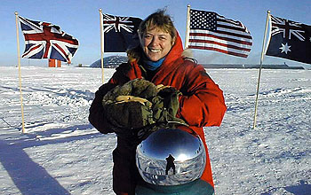 Physician Jerri Nielsen at the ceremonial South Pole marker.