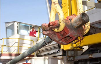 Photo of scientists preparing to drill into the sea-floor crust in the equatorial Pacific Ocean.