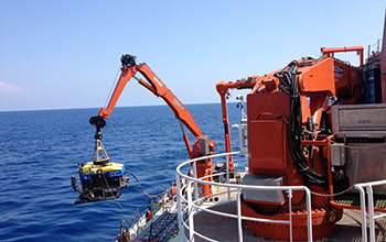 The remotely operated vehicle Jason being lowered into the water from the research vessel.
