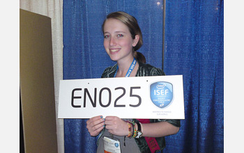 Julia Poje, at this year's Intel International Science and Engineering Fair, holding a sign.