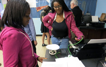 Buford Middle School students measure the output of a speaker they made with a 3-D printer.