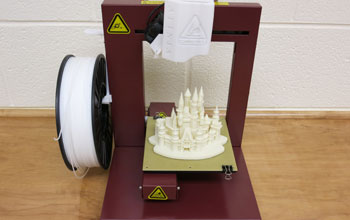A 3-D printer and its finished product made from ABS plastic are shown.