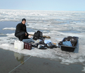 Researcher James McClelland sampling water during ice break-up in Kaktovik Lagoon, Alaska.