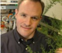 Jay Keasling poses with artemisia. The plant's genes are useful for creating antimalaria drugs.