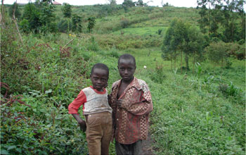 Photo of two children at the edge of Kibale National Park, Uganda.