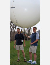 Scientists prepare to launch a balloon to test an emergency deflation system designed for the blimp.