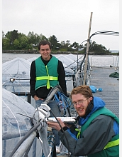 Scientists Max Zeigler and Karl Haase conduct experiments on ocean chemistry.