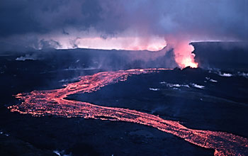 Photo taken at night of incandescent lava flowing downslope from a vent at Iceland's Krafla volcano.