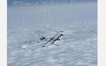 Photo showing an aerial view of the camp on shore, 100 kilometers north of the Arctic Circle.