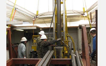Photo of U.S. and Russian drillers recovering cores.