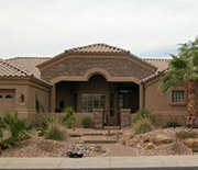 A house and yard with xeriscaping.