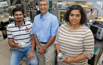 Photo of Ankit Kalani, Satish Kandlikar and Kirthana Kripash holding a LED light cooling device.