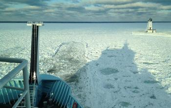 R/V Sikuliaq backs up and rams through to break snow-packed ice.