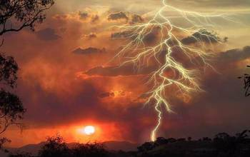 lightning in the sky above a wildfire