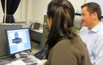 Li Shi and graduate student, Gabriel Coloyan at a computer exploring germanane.