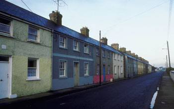 Image of row houses along a street in a working class neighborhood.