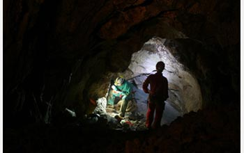 Photo of researchers collecting microbial biofilms in the Frasassi cave system, central Italy.