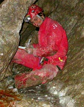 Photo of Jennifer Macalady collecting microbial samples in the Frasassi cave system.