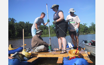 Photo of researchers preparing a platform for collecting sediment cores from Silver Lake, Ohio.