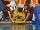 Photo of two Long Beach City College ROV Team members launching the ROV in the pool.