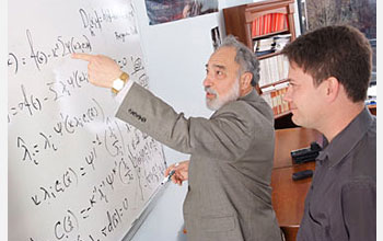 Photo of two men in at a whiteboard