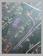 Mathematical equations on chalkboard.