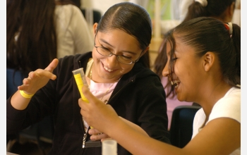 Girls with test tubes in science lab.