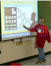 Photo of a middle-school student describing a mathematical image on a screen.