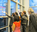 People looking at a reaerch poster session