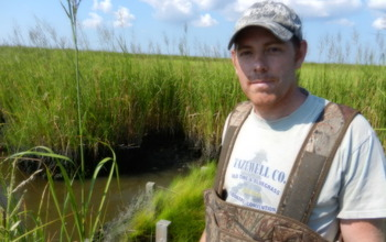 Scientist Matthew Kirwan doing research in Chesapeake Bay wetlands.
