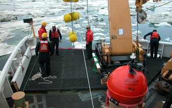 Researchers deploy Mooring flotation balls during a research expedition.