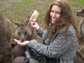 Photo of Michelle Meighan feeding a kangaroo during her summer in Tasmania.
