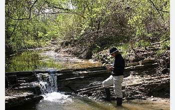 Geologist Gerta Keller looks at sediment samples along the Brazos River in Texas.